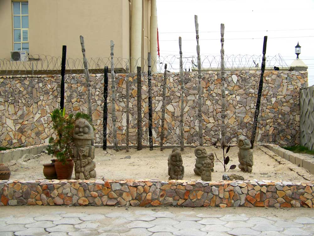 Stone sculptures from Osun adorn the inner courtyard at the Nike Art Gallery
